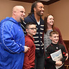 (Brad Davis/The Register-Herald) The Bowers family of Morgantown, consisting of (from left) John, Maddox, 10, Mason, 8, and Kerry pose for a quick photo with Arizona Cardinals receiver Larry Fitzgerald prior to the Big Atlantic Classic Tip-Off Banquet Sunday afternoon at the Beckley-Raleigh County Convention Center.