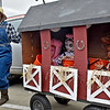 (Brad Davis/The Register-Herald) Farmer mom Leslie Treadway makes her way from place to place hauling a barn full of farm animals, a.k.a. her kids (from left) Christian (pig), 3, Jasmine (cow), 3, and Skye (horse), 5, during Tailgate Halloween Saturday afternoon atop Beckley's Intermodal Gateway.