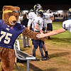 (Brad Davis/The Register-Herald) Nicholas County player Colten Keener gets some encouragement from the Grizzly mascot against PikeView Friday night in Gardner.