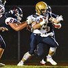 (Brad Davis/The Register-Herald) Shady Spring's Tyler Bragg rumbles ahead as Independence's Logan Muncy tries to stop him Friday night in Coal City.