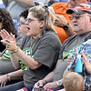 (Brad Davis/The Register-Herald) West Virginia Miners fans Michelle (clapping) and Ken Scarbro (right of Michelle) take in the action during the team's home opener against the Butler Blue Sox Thursday night at Linda K. Epling Stadium.