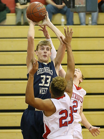 (Brad Davis/The Register-Herald) Greenbrier West's Riley O'Dell pulls up for a short-range jumper as Independence defenders Niko Burgess (#23) and Blake Stone try to defend Friday night in Coal City.