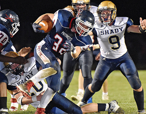 (Brad Davis/The Register-Herald) Independence's Jared Goddard rumbles through Shady Spring defenders Friday night in Coal City.