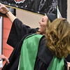(Brad Davis/The Register-Herald) Summers County High School graduate Bryanna Bragg takes a selfie with principal Kari Vicars during the school's commencement ceremony Friday evening in Hinton.