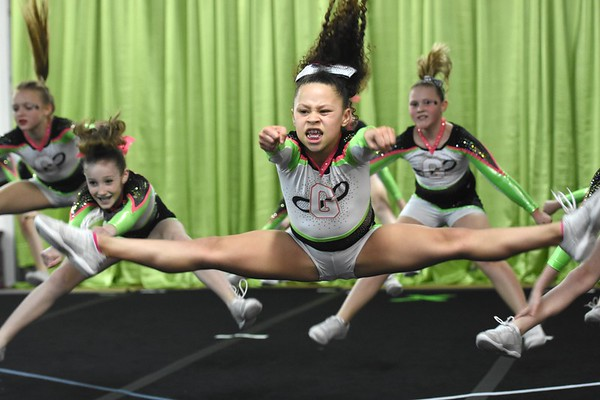 Gretchen Dunlap, left, Hannah Beeson, Amya Grasty and Halee Jones with GymFinity All-Star team, Galaxy, preparing for a  traveling cheerleading competition.