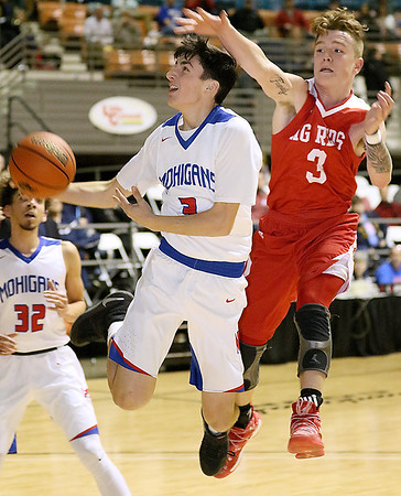 (Brad Davis/The Register-Herald) Morgantown's Cameron Selders drives and scores as Parkersburg's Cam White defends during Big Atlantic Classic action Friday night at the Beckley-Raleigh County Convention Center.