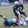 Adam Falbo grabs on to the leg of Fayetteville running back, Jordan Dempsey. Chad Foreman for the Register-Herald.