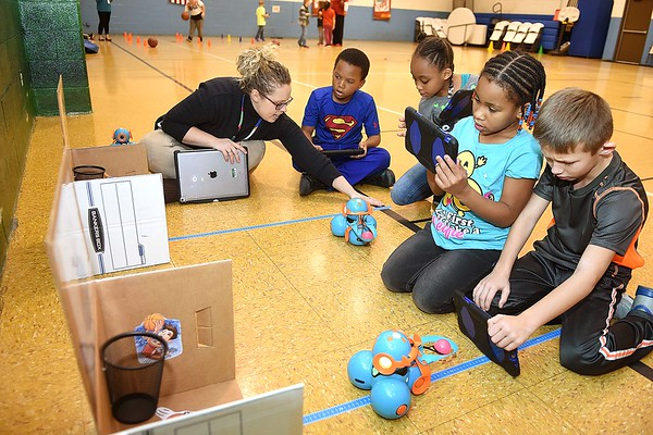 """Audrey Williams, technology intergration specialist Raleigh County School, left, works with, Eric Miller, Antonasia Scruggs, Myava Watson and Jagger Hodge, second graders, during a Legacy Lab class at Cranberry-Prosperity School. They are working at one of the four stations called, """"Dash's Bssketball."""" Cranberry Prosperity has been awarded with the status of being an """"Apple Distinguished School"""" for being top notch with technology use in their classrooms.<br /> (Rick Barbero/The Register-Herald)"""