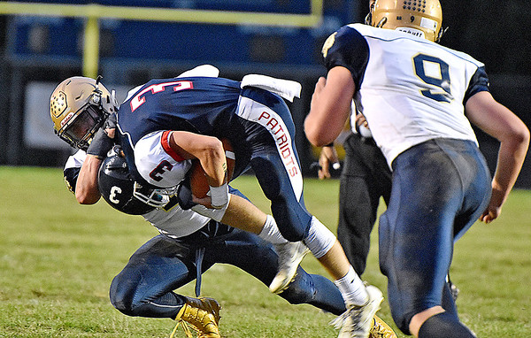 (Brad Davis/The Register-Herald) Shady Spring's Dylan McCall wrangles Independence's Matt McKinney to the ground Friday night in Coal City.