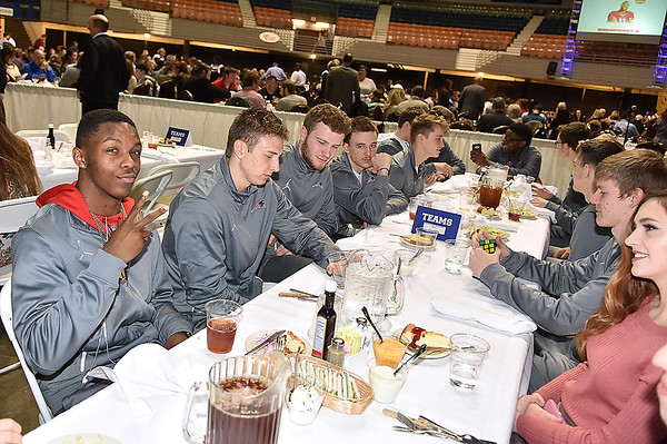 (Brad Davis/The Register-Herald) Independence's Markus Guy, far left, notices the camera at the Patriots' table during the Big Atlantic Classic Tip-Off Banquet Sunday afternoon at the Beckley-Raleigh County Convention Center.