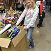 (Brad Davis/The Register-Herald) Volunteer Paige Powers strikes a pose during the annual Mac's Toy Fund event Saturday morning at the Beckley-Raleigh County Convention Center.