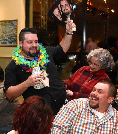 (Brad Davis/The Register-Herald) Curry Wooldridge shows he can rack up the dollars as one fan hands him some cash, while another stuffs a few bills into his pants during the annual Hunks in Heels fundraising event for the Women's Resource Center Friday night at the Beckley Moose Lodge.