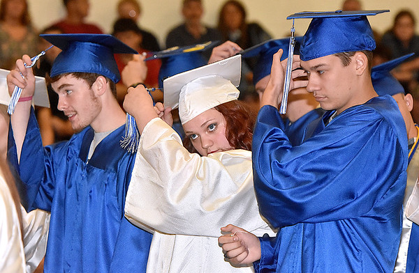 (Brad Davis/The Register-Herald) Graduating seniors reach to turn their tassels to the left during the closing moments of Meadow Bridge High School's 2017 commencement ceremony Saturday afternoon.