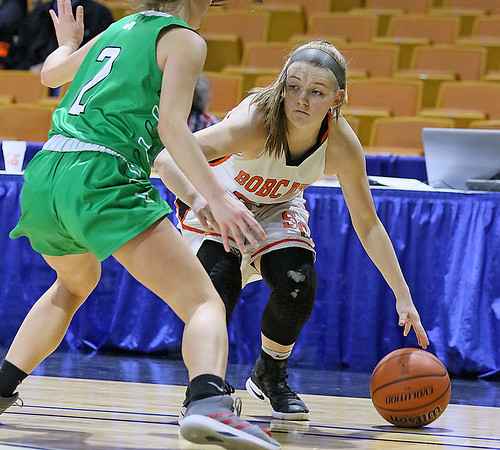 (Brad Davis/The Register-Herald) Summers County's Tiffani Cline looks for an open teammate along the perimeter during the Lady Bobcats' opening round State Tournament win over Charleston Catholic Wednesday evening at the Charleston Civic Center.