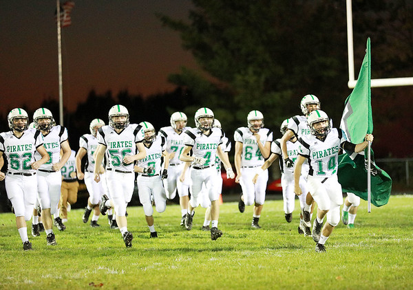 Fayetteville Football team rushes onto the field prior to their football game against Midland Trail  Friday in Hico. (Chris Jackson/The Register-Herald)