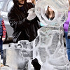 (Brad Davis/The Register-Herald) Ice sculptor Steven Halliday's work begins to take shape as a gift-bearing Christmas elf during the Lewisburg Holiday Festival Saturday afternoon.