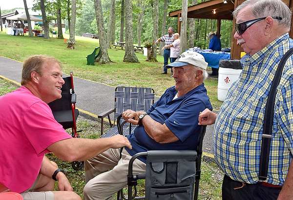 (Brad Davis/The Register-Herald) Shenandoah, Virginia resident Chris Lilly, left, shares a few laughs with Jumping Branch resident Dick Meador, middle, and his dad Roger Lilly, right, as the younger Chris listens to stories of days past with the two elders during the annual Lilly Family Reunion Saturday afternoon near Ghent. Roger Lilly used to work for Dick Meador on a strawberry farm he owned and it was the first job he ever had.