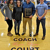 "(Brad Davis/The Register-Herald) Former Summers County Lady Bobcats basketball coach Wayne Ryan poses for a quick photo with son Matt, wife Robin and daughter Lindsay following a court dedication ceremony Friday night in Hinton. It will now be known as the ""Coach Wayne Ryan Court."""