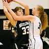 (Brad Davis/The Register-Herald) Westside's Morgan Thomas keeps the ball away from Wyoming East's Emily Saunders after grabbing a defensive rebound during the Renegades' sectional championship win over county rival and defending state champion Wyoming East Wednesday night in Clear Fork.