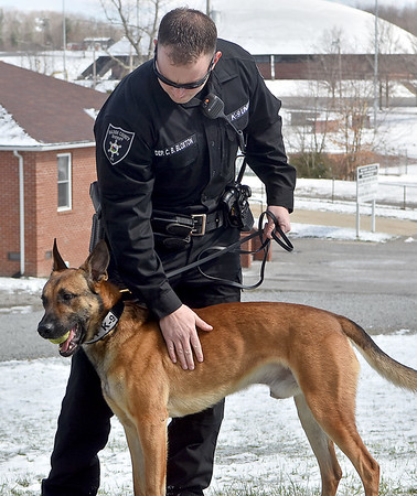 (Brad Davis/The Register-Herald) Deputy C.B. Bloxton handles Leo as Raleigh County Sheriffs introduce their four new K-9 units during a media visit to their Eisenhower Drive station Wednesday afternoon.
