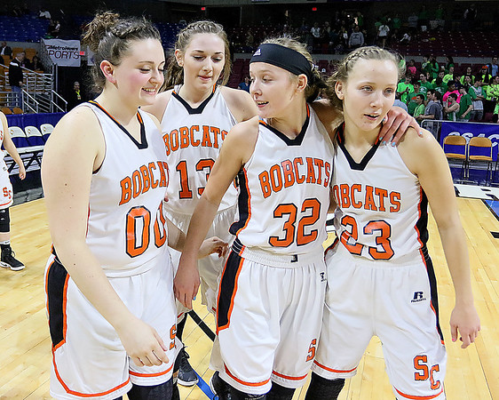 (Brad Davis/The Register-Herald) Summers County players (from left) Erica Merrill, Hannah Taylor, Whittney Justice and twin sister Brittney congratulate one another after the Lady Bobcats' hard-fought win over Charleston Catholic in the opening round of the Class A Girls State Tournament Wednesday evening at the Charleston Civic Center. The Lady Bobcats will play in the second round Friday afternoon at 1:00 p.m.