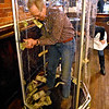 (Brad Davis/The Register-Herald) Beckley resident Bill Eades takes a turn inside the United Bank money machine during Celebrity Night at Foster's May 8. Eades managed to grab nine dollars.