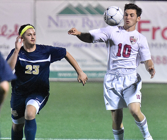 (Brad Davis/The Register-Herald) Woodrow Wilson's Austin Hatfield battles for a loose ball with Shady Spring's Joel Scarbro on Flying Eagles senior night Thursday at the YMCA Paul Cline Memorial Sports Complex.