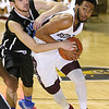(Brad Davis/The Register-Herald) Woodrow Wilson's Courtney Walton drives to the basket as Teays Valley Christian's Skylar Sigman defends during the opening night of the Battle for the Armory Basketball Tournament Thursday night at the Beckley-Raleigh County Convention Center.