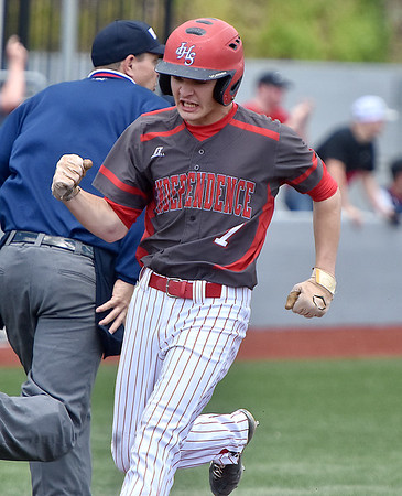 (Brad Davis/The Register-Herald) Independence's Fisher Horton reacts as he crosses the plate for the game-tying run off a single from teammate Tyler Haga during the 7th inning of the first game against James Monroe Friday afternoon at Linda K. Epling Stadium.