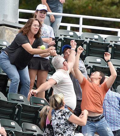 (Brad Davis/The Register-Herald) Fans try to catch an autographed ball at the Greenbrier Champions Tennis Classic Saturday afternoon in White Sulphur Springs.