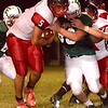 Oak Hill's Christian Lively attempts to break through the Fayetteville defense. Chad Foreman for the Register-Herald.