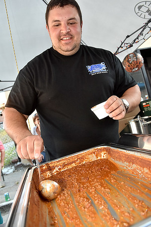 (Brad Davis/The Register-Herald) Will Laxton, manning the Laxton's Auto Repair & Wrecker Service booth, finds himself already scraping the bottom of the pan on their popular chili offering less than 50 minutes into Beckley's annual Chili Night event Saturday evening.
