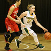 (Brad Davis/The Register-Herald) Greenbrier East's Kate Perkins hustles up the court as Parkersburg's Shay Lee Kirby keeps pace during Big Atlantic Classic action Saturday afternoon at the Beckley-Raleigh County Convention Center.