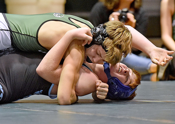 (Brad Davis/The Register-Herald) Park's Alex Webb, top, takes on Western Greenbrier's Mason Brown in a 145-pound weight class matchup during the Wayne Bennett Duals Saturday morning at Park Middle School. Park's Webb would pin Brown to win the match.