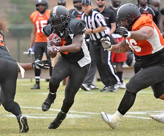 (Brad Davis/The Register-Herald) South (black) running back Josh Robinson rumbles ahead during Spring League action Sunday afternoon in White Sulphur Springs.