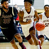 Woodrow Wilson's Isaiah Francis drives past a George Washington player during the second quarter of their basketball game at the Beckley-Raleigh County Convention Center in Beckley on Tuesday. (Chris Jackson/The Register-Herald)