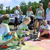 (Brad Davis/The Register-Herald) Two-year-old Brenner Davis plays with some leftover colored starch following the United Way of Southern West Virginia's annual Color Me United Walk/Run Saturday morning at the Raleigh County Memorial Airport.