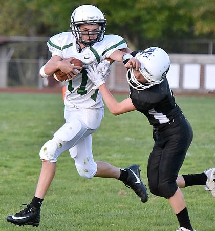 (Brad Davis/The Register-Herald) Park quarterback Caleb Austin fends off would-be Beckley-Stratton tackler Trey Pauley with a brutal stiff-arm Thursday night at Woodrow Wilson's Van Meter Stadium.
