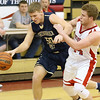 (Brad Davis/The Register-Herald) Greenbrier West's Adam Johnson and Independence's Dylan Dickens collide following a long, football-style Cavaliers pass up the court Wednesday night in Coal City.