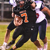 (Brad Davis/The Register-Herald) Summers County's Tucker Lilly carries the ball against Independence Friday night in Hinton.