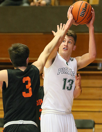 (Brad Davis/The Register-Herald) Fayetteville's Will Fenton pulls up for a shot as Summers County's Cordell Meadows defends during the Class A Boys Region 3 Co-Final Thursday night at the Soldiers & Sailors Memorial.