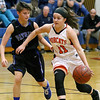 (Brad Davis/The Register-Herald) Summers County's Taylor Isaac hustles up the court as Midland Trail's Skylar Lesher defends Thursday night in Hinton.