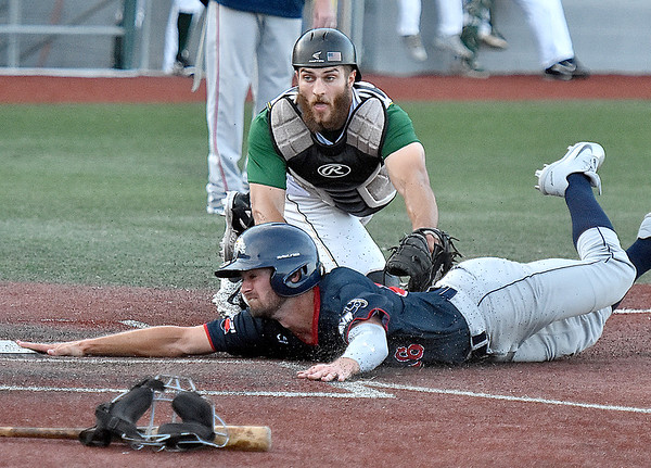 (Brad Davis/The Register-Herald) Chillicothe baserunner Neil Lambert dives in to score a run before Miners catcher Matt DiLeo can get the tag on him during the top of the 3rd inning Saturday night at Linda K. Epling Stadium.