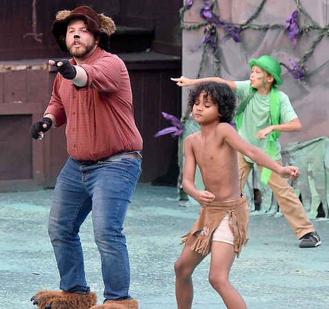 (Brad Davis/The Register-Herald) Baloo, played by Brooks Cline, and Mowgli, played by Jeremiah Allen, dance through a musical scene during Theatre West Virginia'a The Jungle Book Kids July 22 at Grandview Park's Cliffside Amphitheatre.