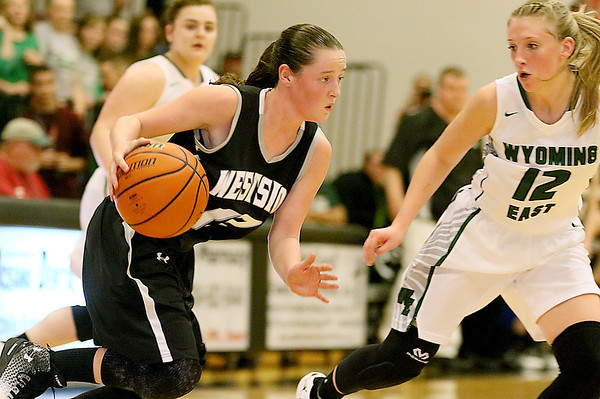 (Brad Davis/The Register-Herald) Westside's Makayla Morgan drives as Wyoming East's Misa Quesenberry defends during the Renegades' sectional championship win over county rival and defending state champion Wyoming East Wednesday night in Clear Fork.