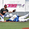 (Brad Davis/The Register-Herald) Shepherd's Jacob Carney dives in to steal 2nd before West Virginia Wesleyan 2nd baseman Tre Kerns can get the tag down during Mountain East Conference Tournament action Saturday afternoon at Linda K. Epling Stadium.