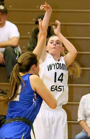 (Brad Davis/The Register-Herald) Wyoming East's Jasmine Blankenship shoots from three-point range as St. Joseph Central's Paige Shy defends during the Lady Warriors' win over the Irish Friday night in New Richmond.