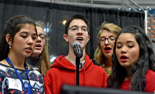 (Brad Davis/The Register-Herald) Vocalists from the St. Francis de Sales Catholic School Youth Choir serenade the crowd with Christmas songs during the annual Mac's Toy Fund event Saturday morning at the Beckley-Raleigh County Convention Center.