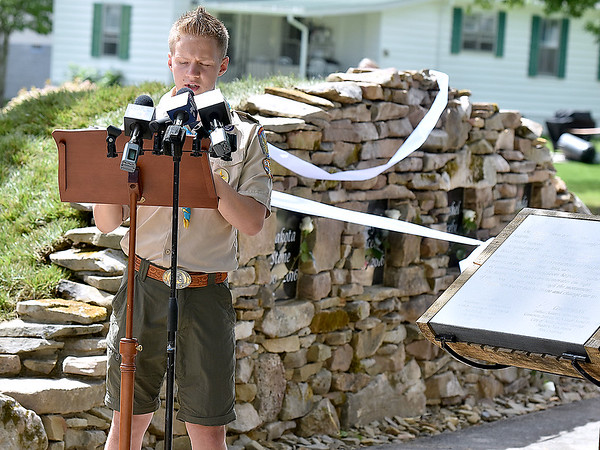 (Brad Davis/The Register-Herald) Boy Scout Cameron Zobrist, who hatched the idea for the memorial behind him after helping fellow residents through the struggle of recovery, gives a quick speech Firday afternoon at Old Mill Park.