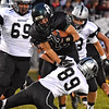 (Brad Davis/The Register-Herald) Wyoming Caleb Bower carries the ball Friday night in New Richmond.